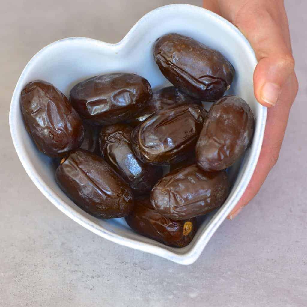 dates inside a heart shaped bowl