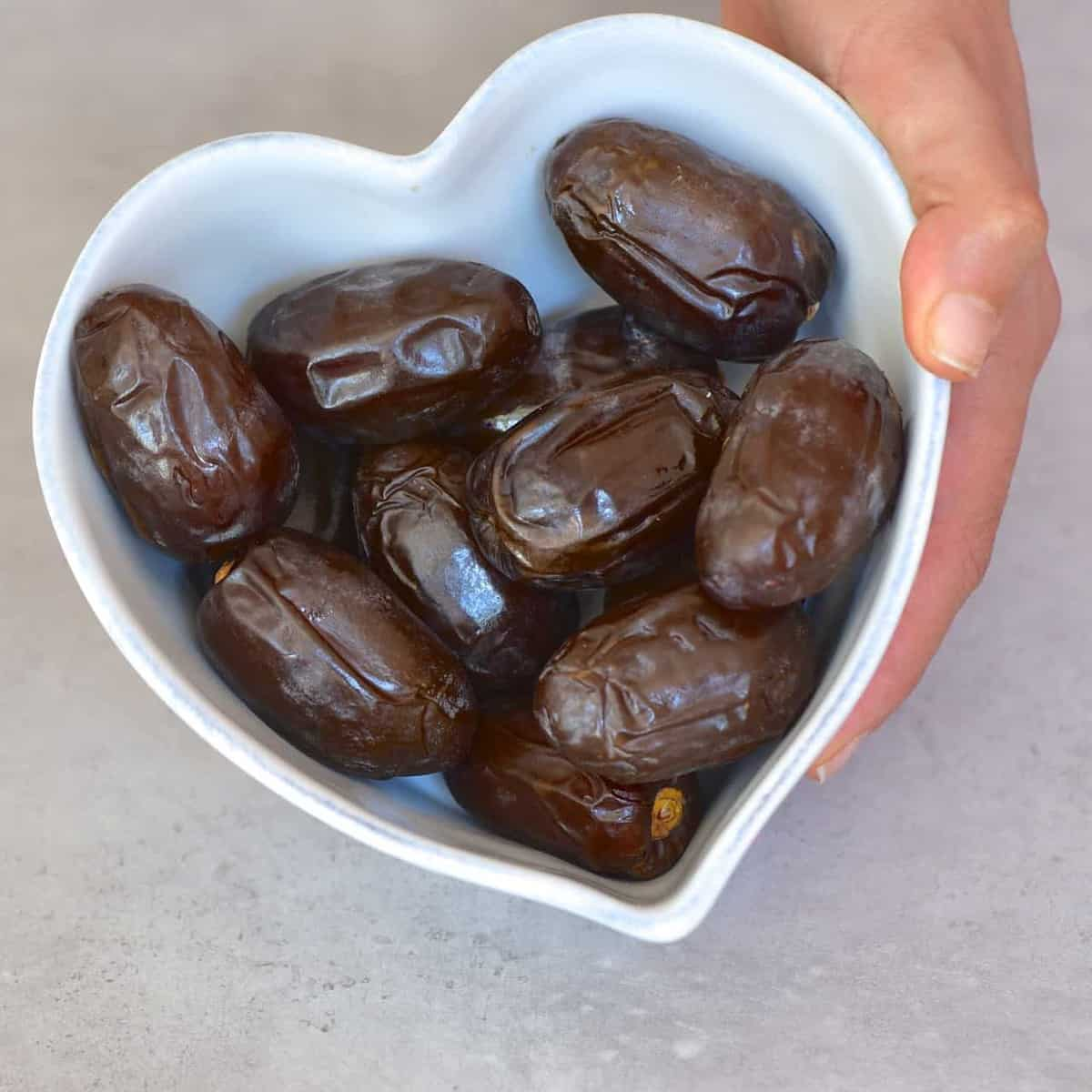 dates inside a heart shaped bowl