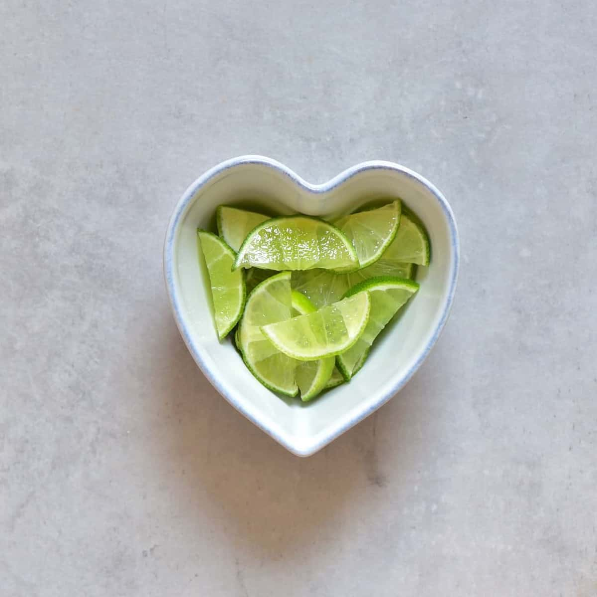wedges of lime in a bowl
