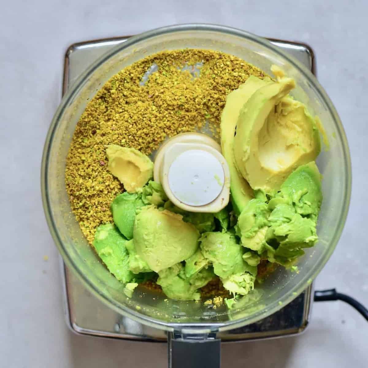 Avocados added to pistachio flour in blender