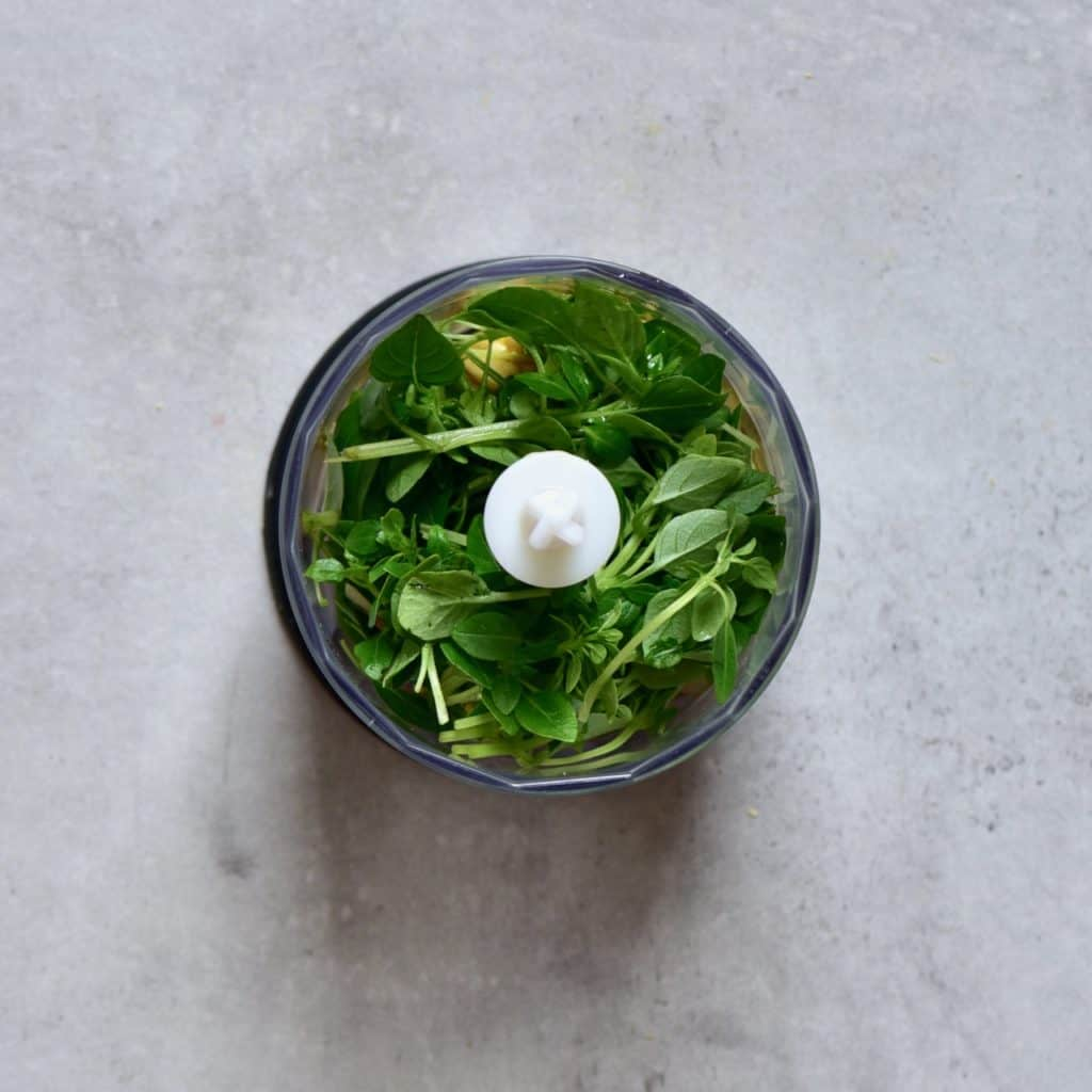 Homemade basil pesto in the making