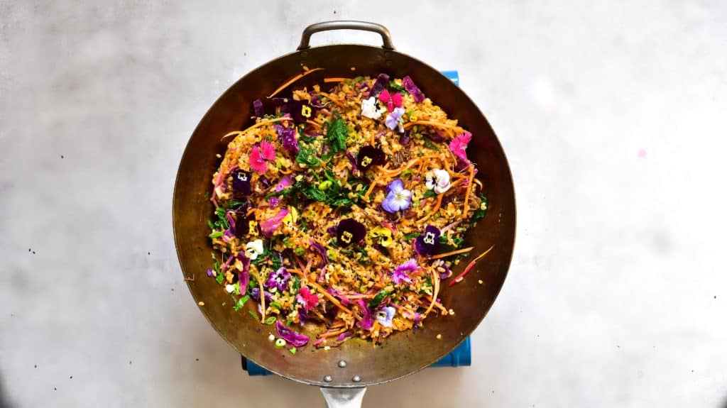 Homemade bibimbap decorated with edible flowers