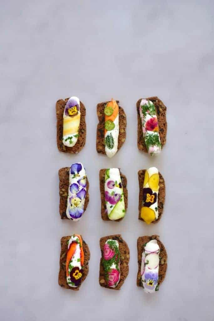 Rainbow cheese rolls on crackers