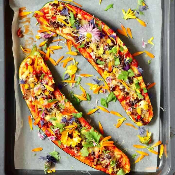 Zucchini boats stuffed with veggies and decorated with edible flowers