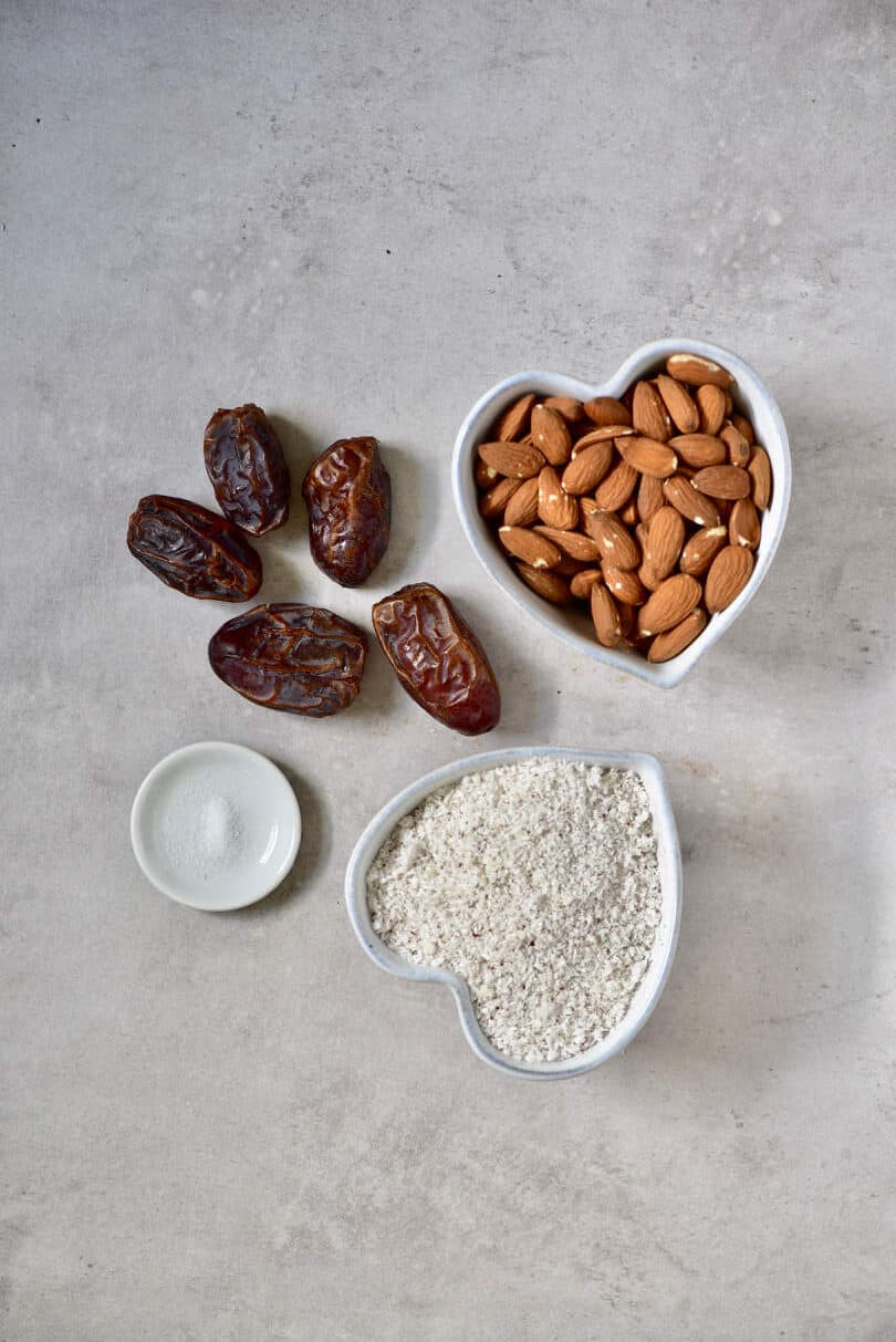 Ingredients for tart base with almonds, shredded coconut and dates