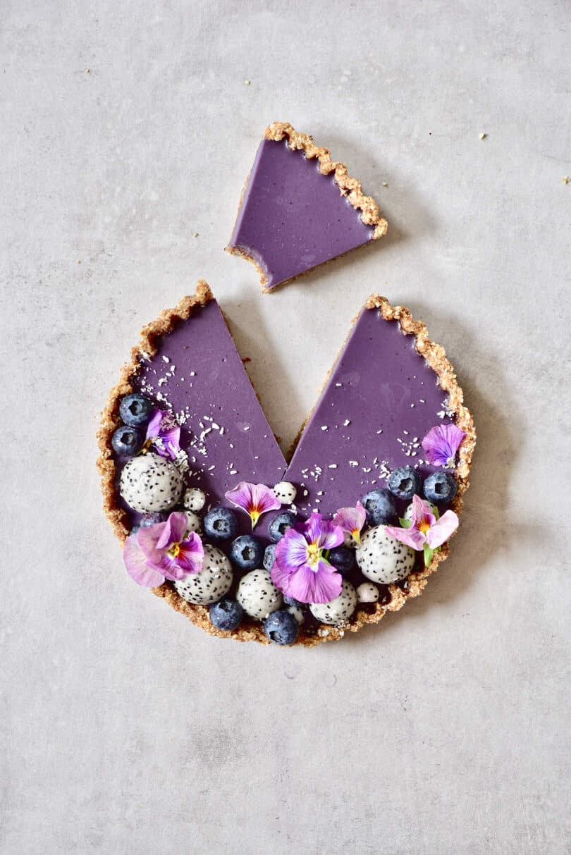 Blueberry tart with a cut slice