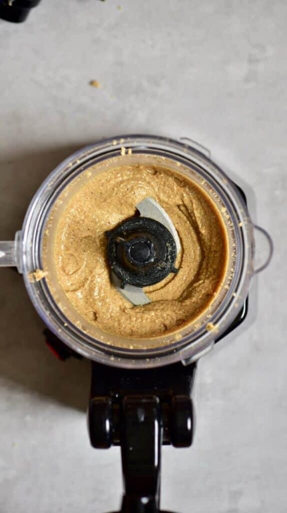 Blended hazelnuts in a blender