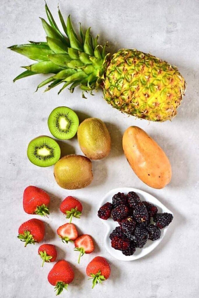 Pineapple kiwi mango strawberries and blackberries