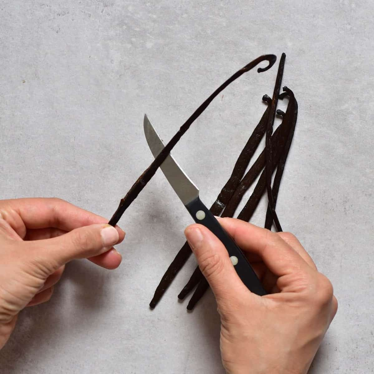 Cutting a vanilla pod with a knife