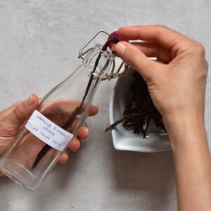 Adding vanilla pods to a small glass bottle