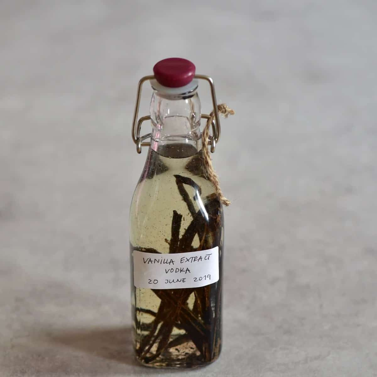 Bottle filled with vanilla pods and vodka