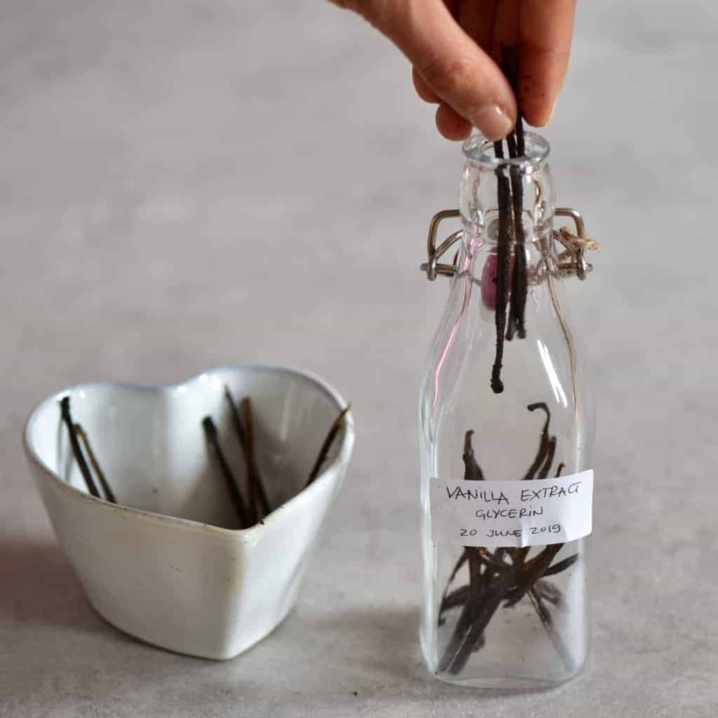 Bottle filled with vanilla pods
