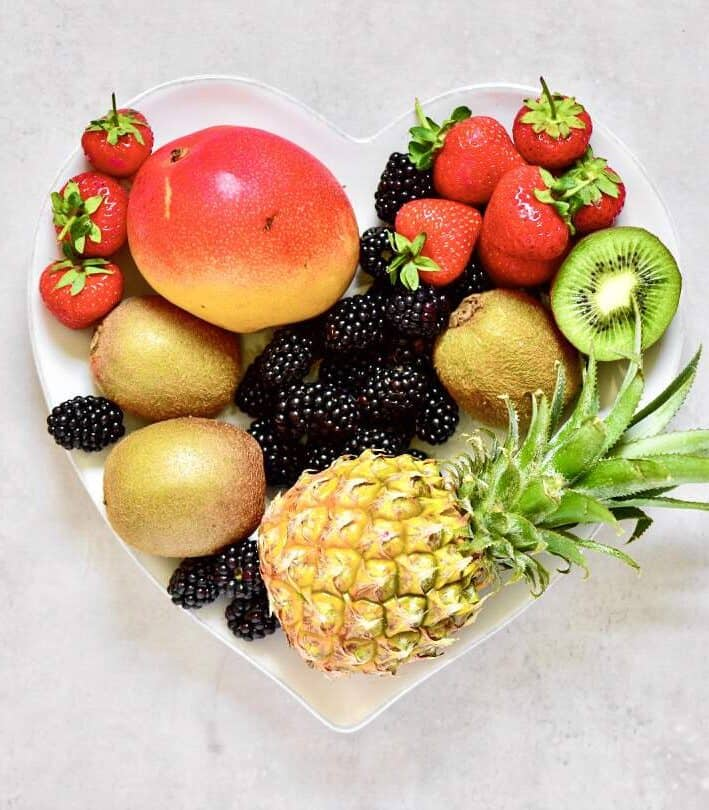 Fresh fruit for fruit lollies - pineapple, kiwi, mango, strawberries, blackberries