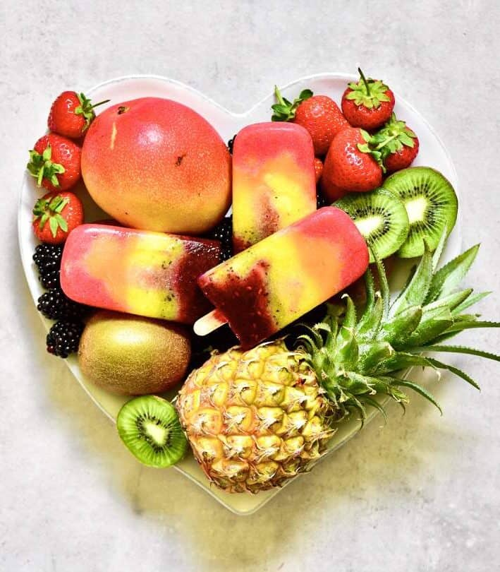 Fruit lollies and fruit in a plate