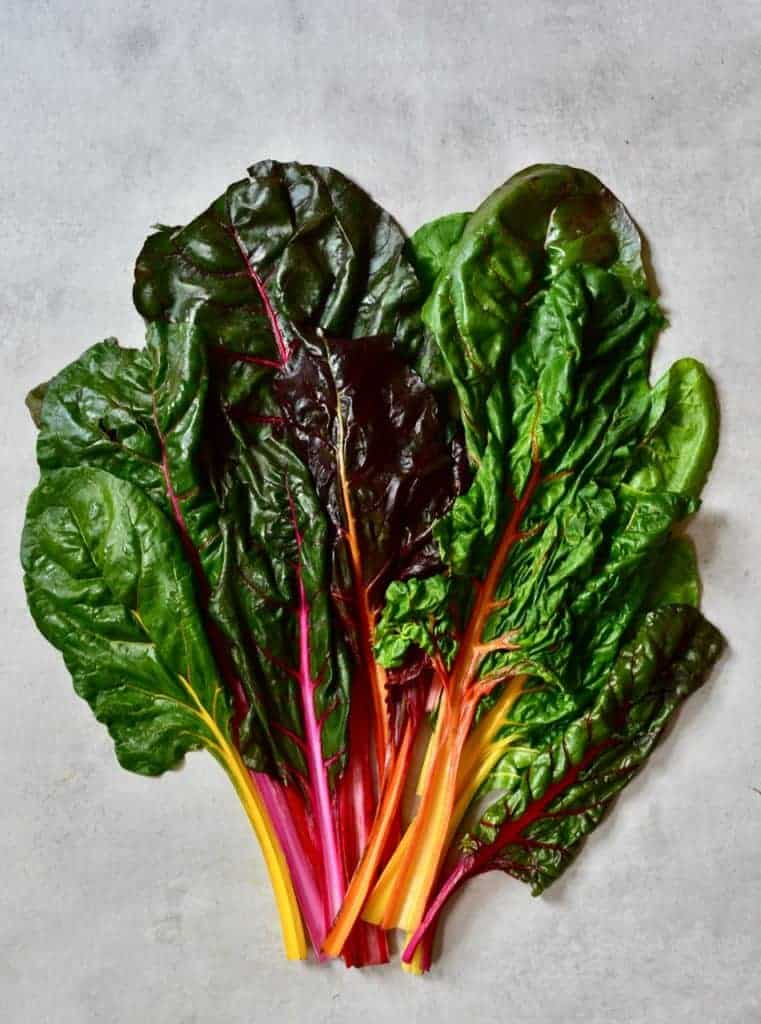 rainbow chard leaves on the table