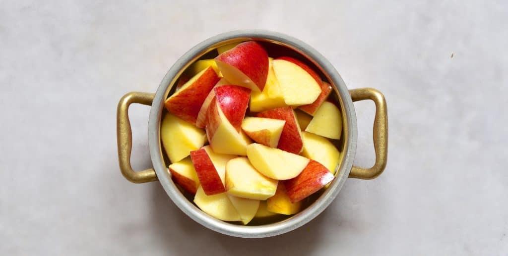 chopped apple in a pot