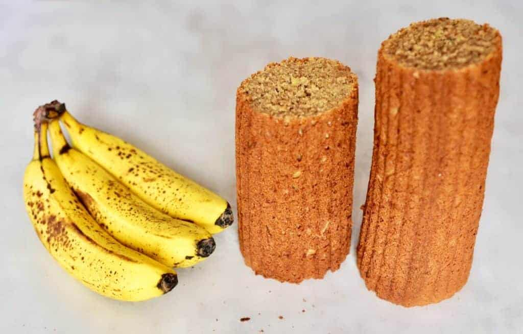 Three bananas and pieces of banana bread