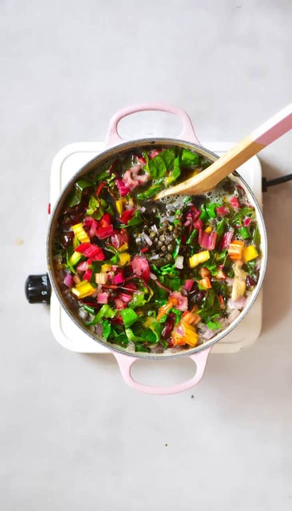 Cooking lentil chard soup in a pot