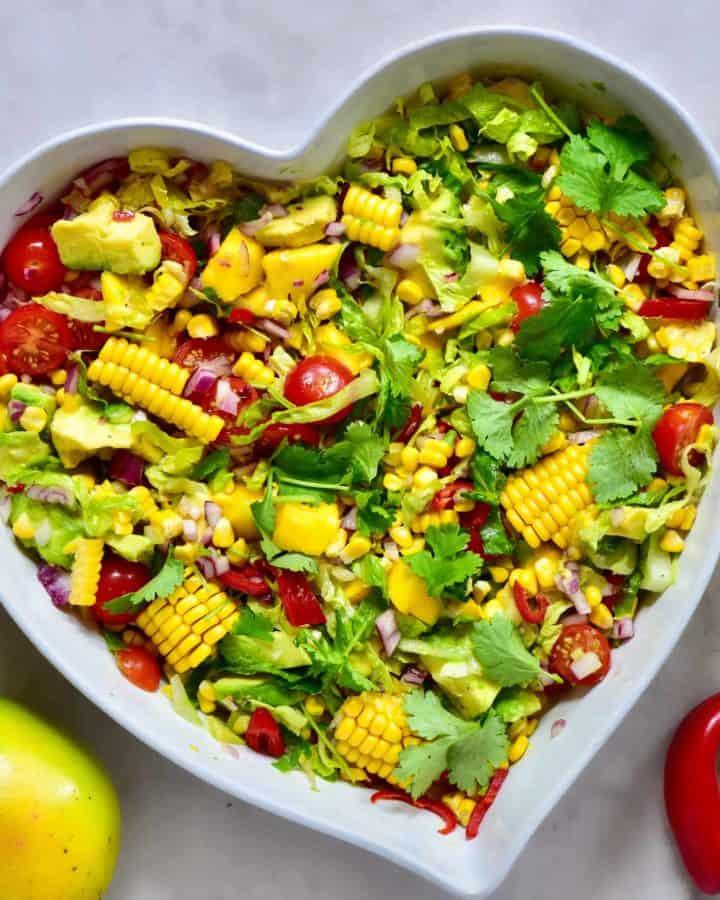 healthy rainbow summer salas with mango, sweetcorn & avocado. Perfect vegetarian bbq recipe and vegetarian salad.