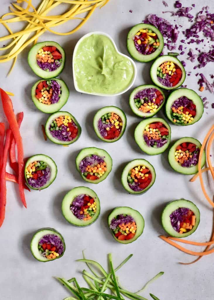 Cucumber sushi pieces with avocado dip