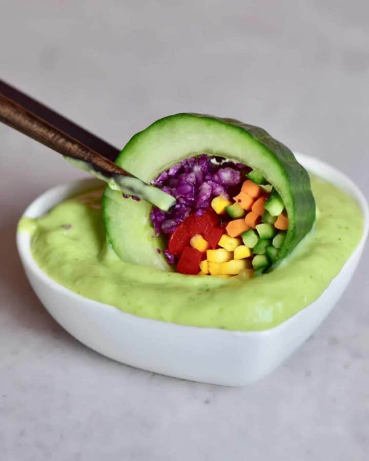healthy 100% plant-based rainbow cucumber sushi rolls with an avocado dip. vegan, low-carb