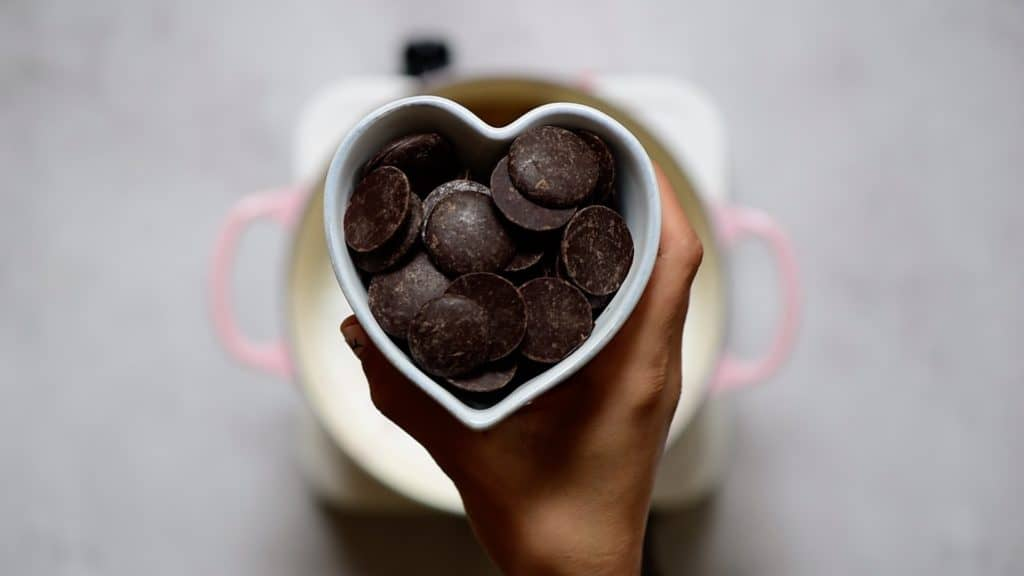 dairy-free dark chocolate chips in a heart shaped bowl