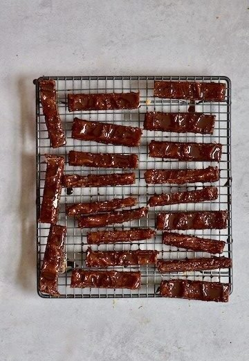 Twix bars laid out on drying rack