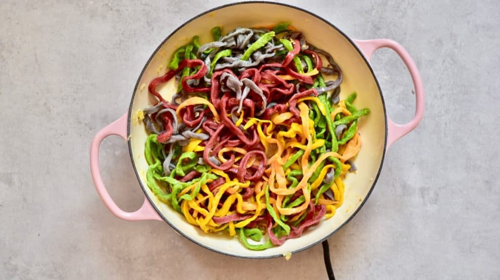 homemade rainbow pasta sauteed with garlic and olive oil