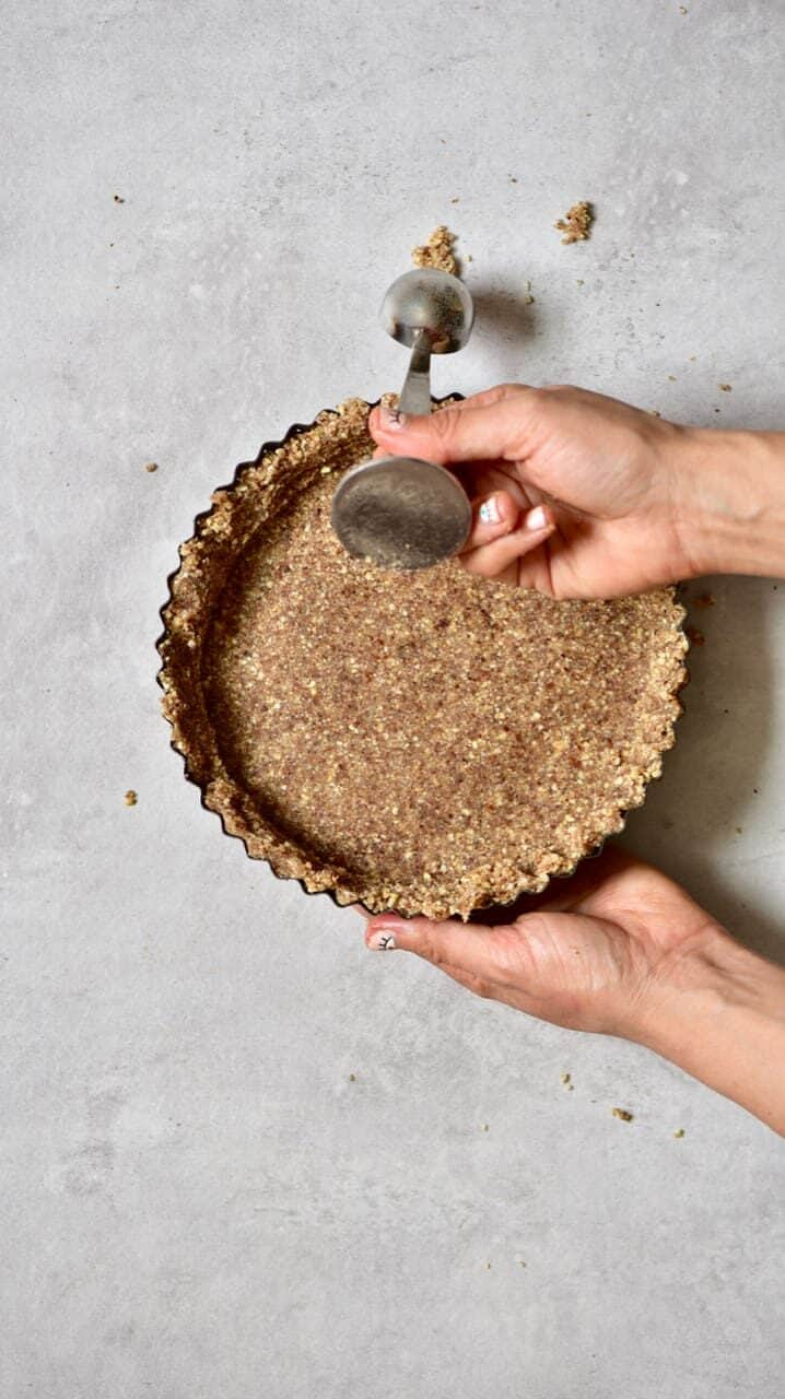 Tart crust spread evenly onto a tart tin
