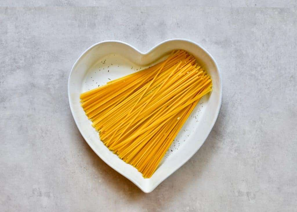 Linguine pasta in a heart shaped dish