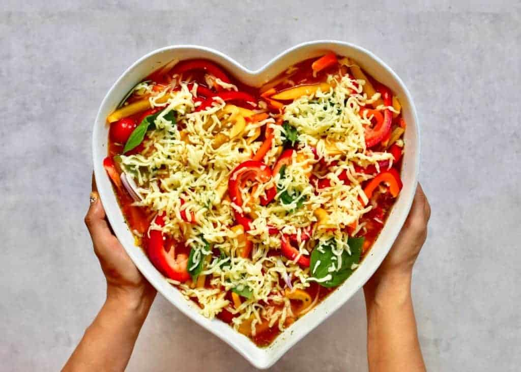 Vegetarian one-pot pasta bake served in a heart shaped dish