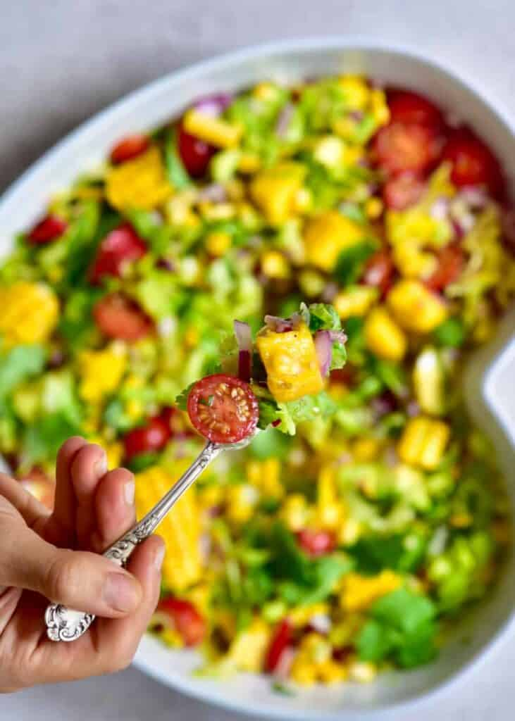 close up of tropical Salad on a fork
