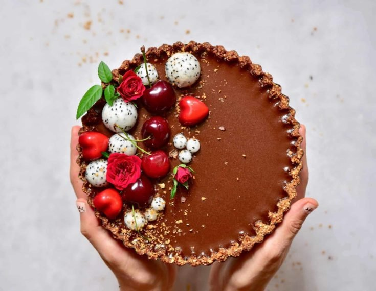 This decadent chocolate cherry 'Black Forest' tart is not only 100% vegan but also refined sugar-free, gluten free and refined sugar free and a deliciously decadent summer dessert recipe!