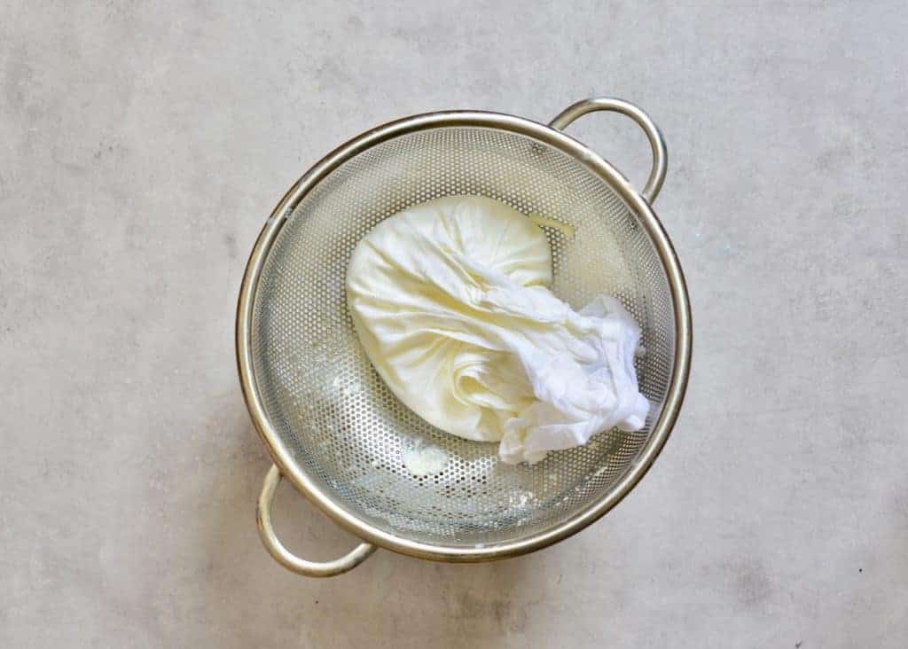straining ricotta cheese in cheesecloth