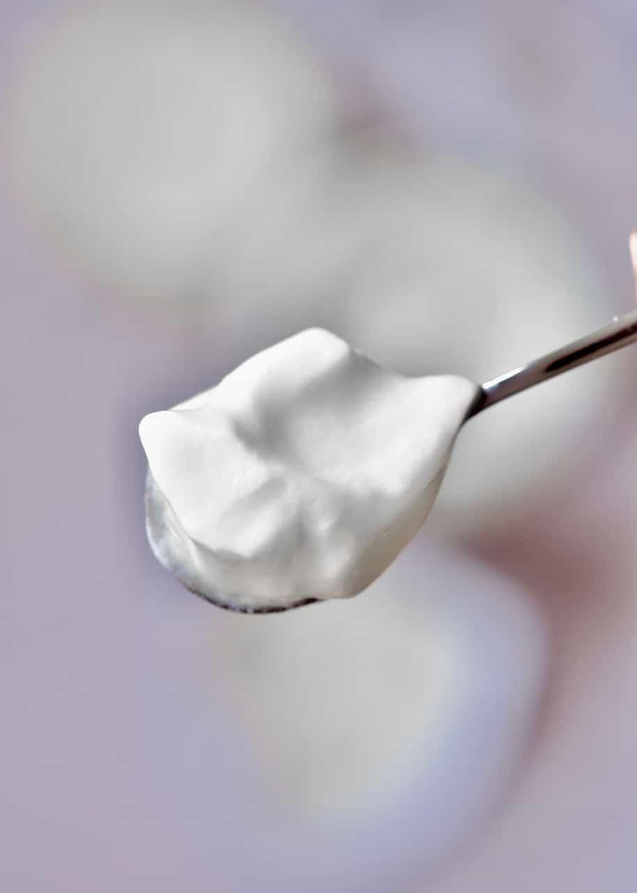 homemade natural yogurt on a spoon