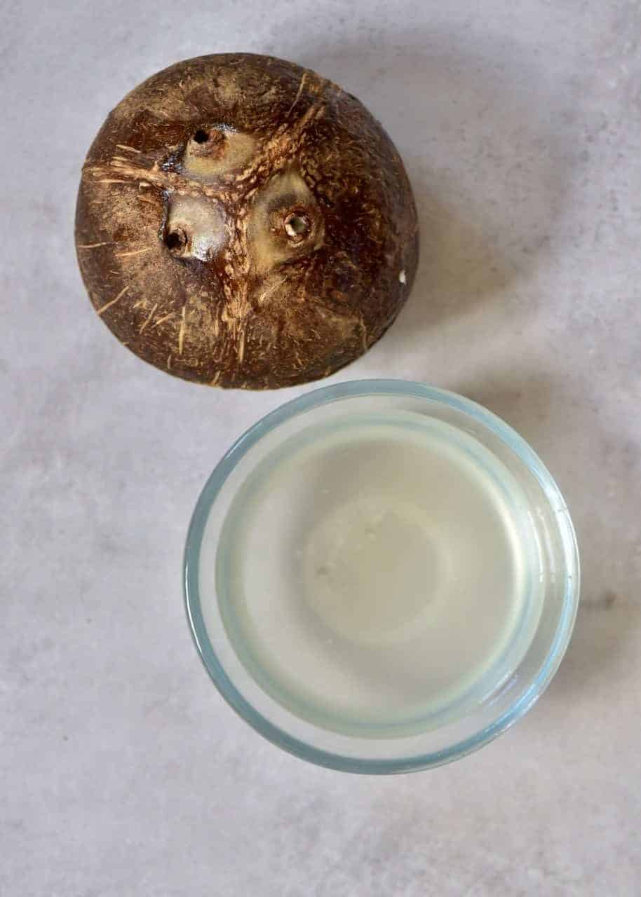 mature Coconut and glass of coconut water