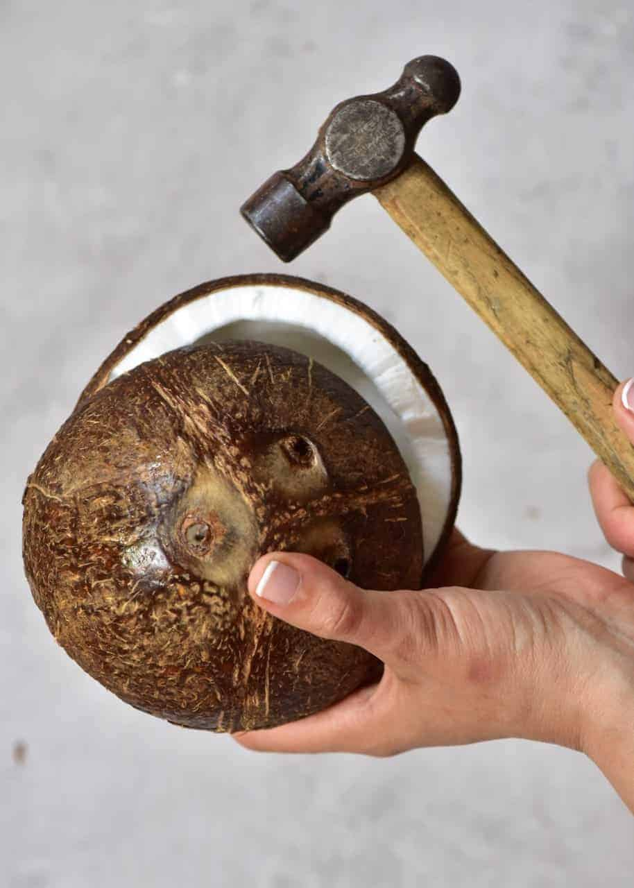 Breaking a coconut with a hammer