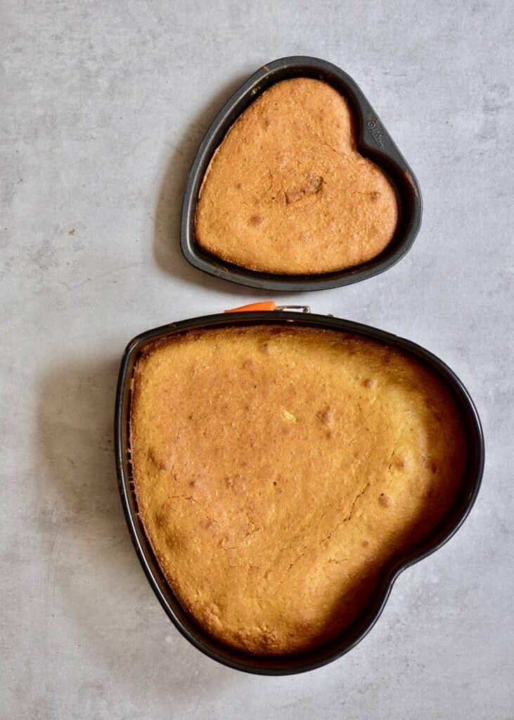 Two heart-shaped baked cakes