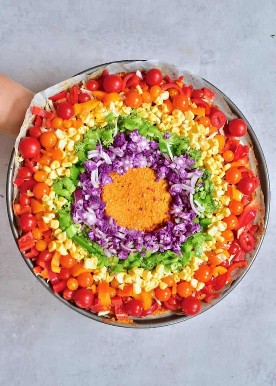 sweet potato crust rainbow pizza topped with rainbow veggies