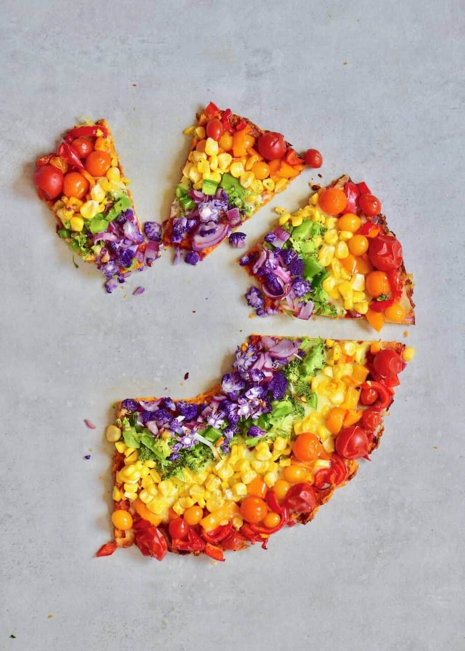 slices of sweet potato crust rainbow pizza.