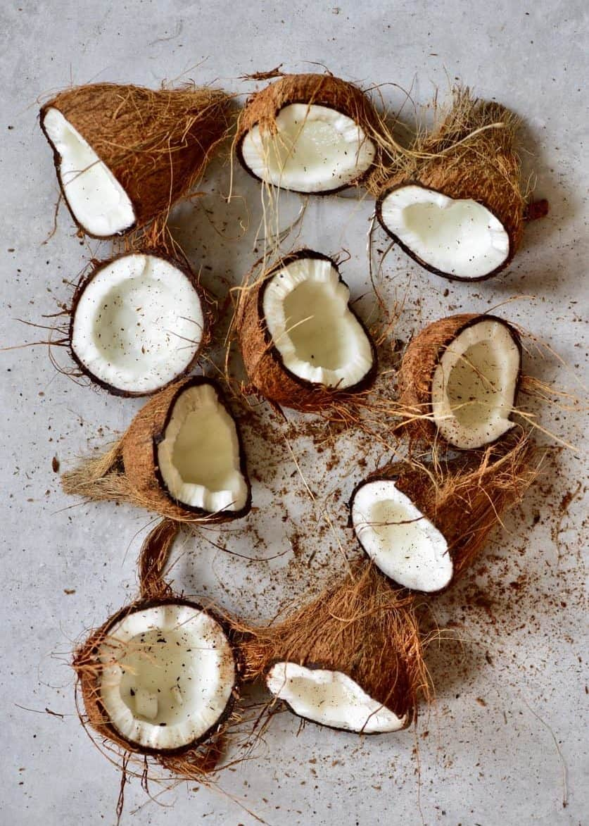 a spread of mature coconuts cut in half