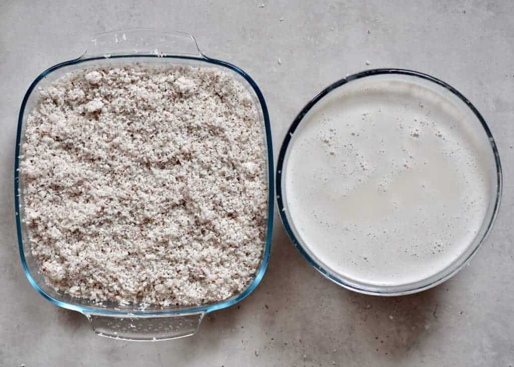 Coconut milk in a bowl and leftover coconut meal in a square container