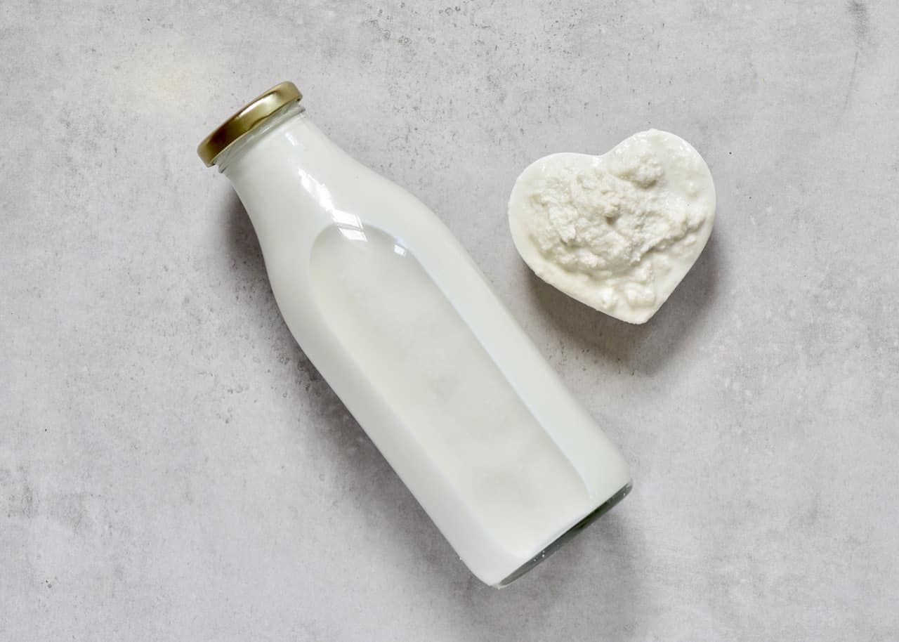 a bottle of homemade cashew milk and the leftover cashew pulp. a delicious dairy free, vegan milk