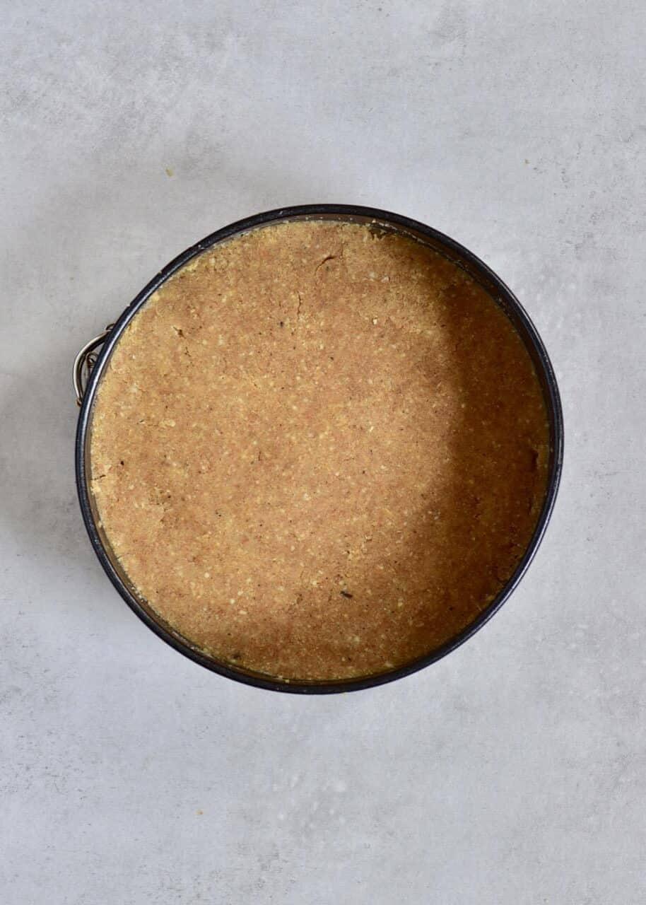 dough spread in a tin