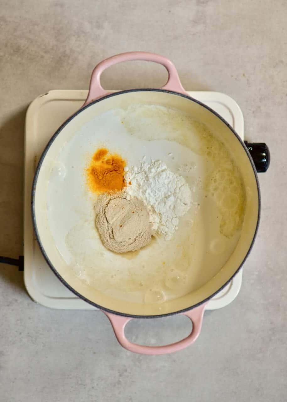 coconut cream turmeric and starch in a pot