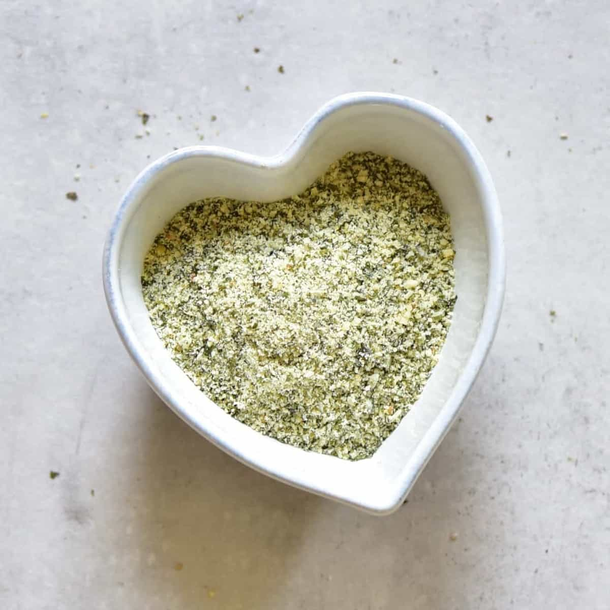 A heart shaped  bowl with blended hemp seeds