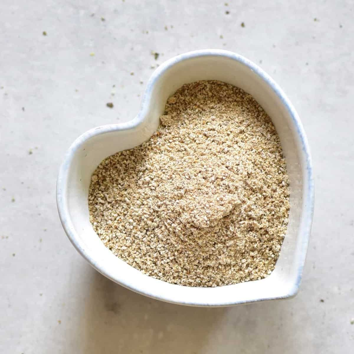 A heart shaped  bowl with blended sunflower seeds