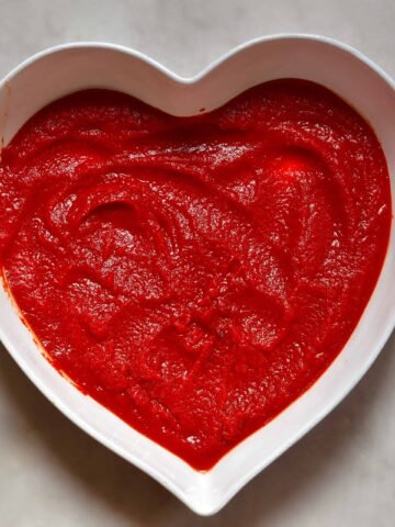 Tomato paste in a heart shaped bowl