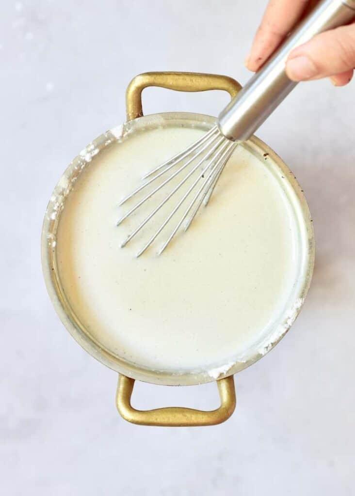 preparing coconut and vanilla vegan tart filling