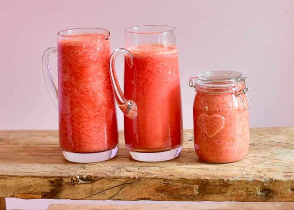 fresh red tomato juice for making homemade tomato puree/ paste